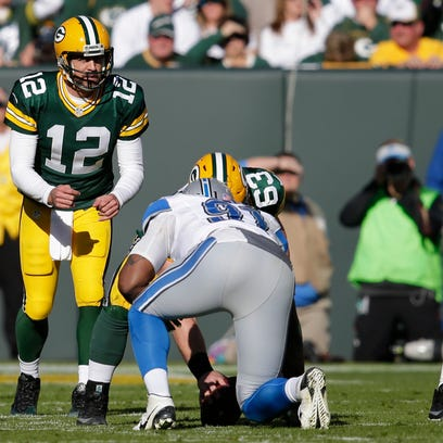 Green Bay Packers' Josh Sitton blocks for Aaron Rodgers.