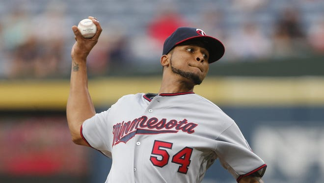 Minnesota Twins starting pitcher Ervin Santana works during the first inning Tuesday against the Atlanta Braves in Atlanta.