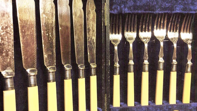 This set of fish knives and forks is from the early 20th century.