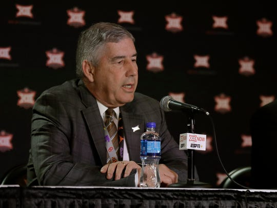 Big 12 commissioner Bob Bowlsby talks to the media after canceling the remaining NCAA college basketball games in the Big 12 Conference tournament due to concerns about the coronavirus Thursday, March 12, 2020, in Kansas City, Mo. The biggest conferences in college sports all canceled their basketball tournaments because of the new coronavirus, seemingly putting the NCAA Tournament in doubt. (AP Photo/Charlie Riedel)