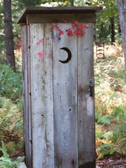 A typical outhouse in Wisconsin, sporting a crescent-moon