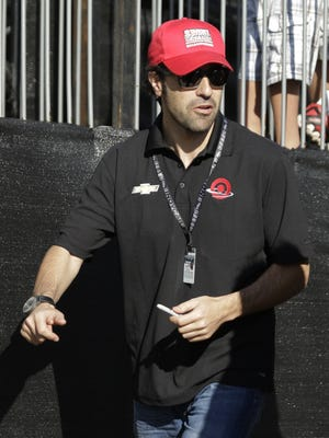 Former driver Dario Franchitti, of Scotland, during final practice before the start of the IndyCar Firestone Grand Prix of St. Petersburg auto race Sunday, March 30, 2014, in St. Petersburg, Fla. (AP Photo/Chris O'Meara)