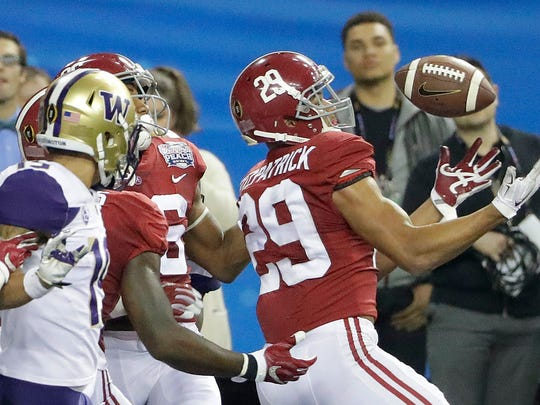 Alabama defensive back Minkah Fitzpatrick (29) intercepts the ball against Washington during the second half of the Peach Bowl NCAA college football playoff game, Saturday, Dec. 31, 2016, in Atlanta. Alabama won 24-7. (AP Photo/David Goldman)