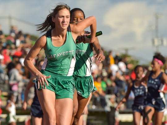Mikaela Vanek takes the baton from Gentry Jacquet during