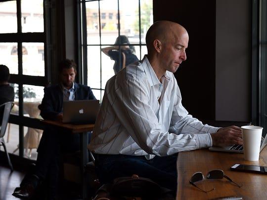 Bill Presler works on his laptop at Edgehill Cafe.