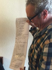 Mike Watt shows off his setlist for his concert at