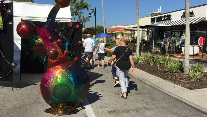 Scenes from a previous Naples Downtown Art Show.