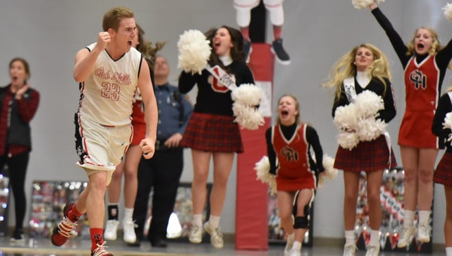Oak Hills senior Nick Strader celebrates hitting a game-tying 3-pointer with seconds left in the first overtime. The Highlanders beat Mason 70-66 in double overtime Friday, Feb. 16, 2018.