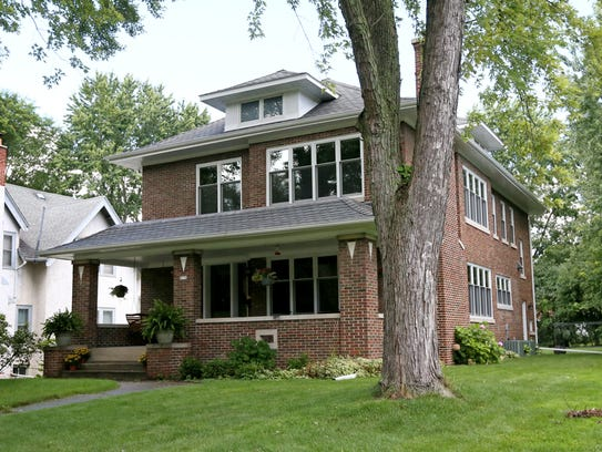 The brick home was built as a duplex in 1920.