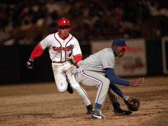 The Lansing Lugnuts' Carlos Beltran rounds the Rockville Cubbies' third baseman en route to scoring a run at Oldsmobile Park during the inaugural game at then-Oldsmobile park on April 6, 1996. Beltran is still playing in the Major Leagues.