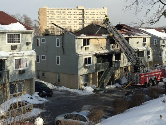 Firefighters continue to work one of the buildings at the Kaal Rock apartment complex Thursday morning after a fire destroyed the building Wednesday night.