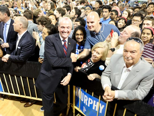Democratic gubernatorial candidate Phil Murphy poses with supporters after his rally in Lyndhurst on Sunday afternoon.