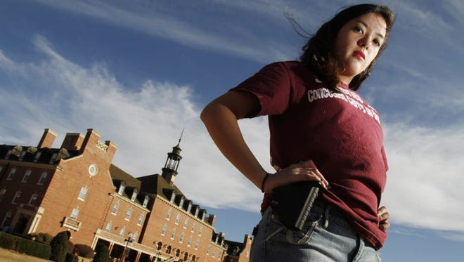Adrienne O'Reilly, Oklahoma director for Students for Concealed Carry on Campus, carries an empty gun holster in 2011 in Stillwater.