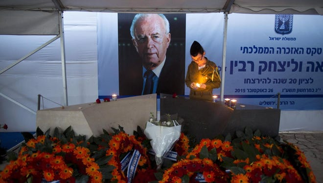 An Israeli soldier lights a memorial candle at former Israeli prime minister Yitzhak Rabin's grave at Mount Herzl Military Cemetery on Oct. 29, 2015.