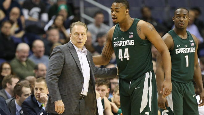 Michigan State head coach Tom Izzo talks to forward Nick Ward (44) in the second half during a Big Ten tournament game.