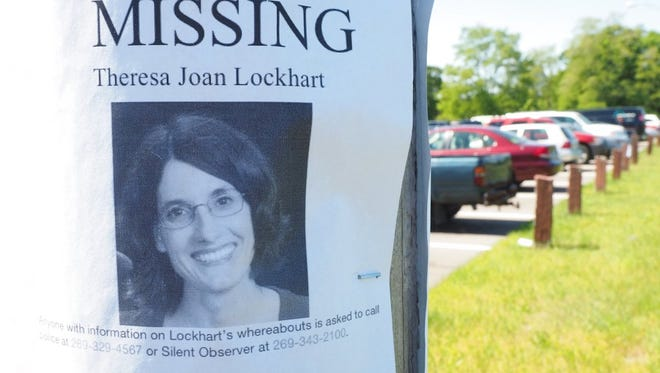 In this May 31, 2017 photo, a K9 search is conducted for Theresa Lockhart in Portage.   Lockhart went missing on May 18, after she was last seen driving away from her home in Portage around 10 p.m. Police said they found her car a few miles from her home at the park and ride on Angling Road and West Centre Avenue.