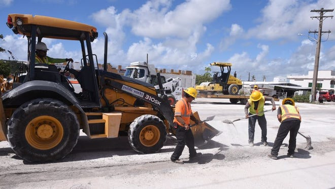 Department of Public Works employees continue improvement work on the road commonly referred to as Hamburger Road in Harmon on Friday, June 16, 2017. A portion of the road near Route 1 will be closed to traffic Saturday, June 17, for paving, DPW said.