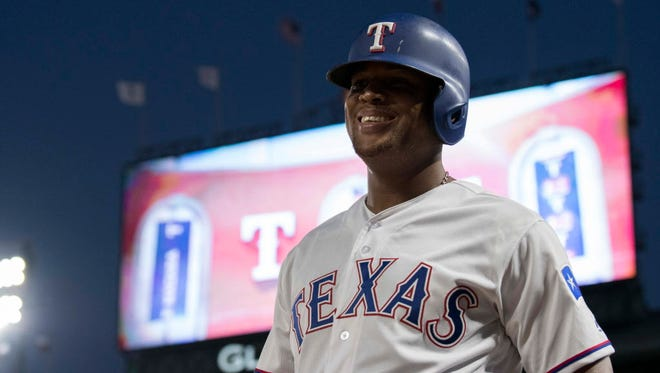 Texas Rangers third baseman Adrian Beltre (29) walks on the field during the fifth inning against the Baltimore Orioles at Globe Life Park in Arlington.