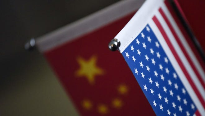 Chinese flags and American flags are displayed in a company in Beijing on Aug. 16.
