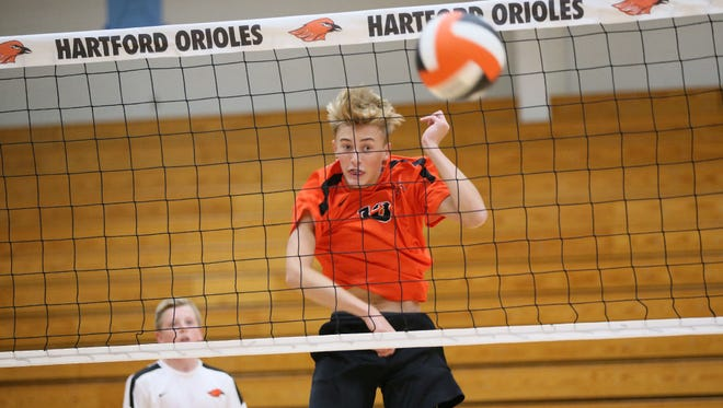 Sophomore Seth Rupert spikes the ball during a recent practice for the first-year boys volleyball team at Hartford.