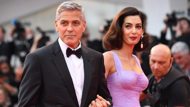 """US actor and director George Clooney and his wife Amal attend the premiere of the movie """"Suburbicon"""" presented out of competition at the 74th Venice Film Festival on September 2, 2017 at Venice Lido.  / AFP PHOTO / Filippo MONTEFORTEFILIPPO MONTEFORTE/AFP/Getty Images ORG XMIT: 775025691 ORIG FILE ID: AFP_S23TC"""