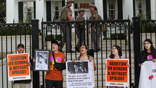 Abortion rights demonstrators at the governor's mansion in Austin in August.