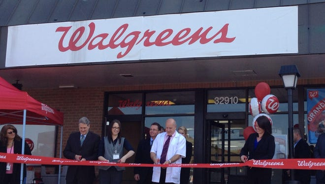 Helping to cut the ribbon at the new Farmington Hills Walgreens store was (from left) Farmington Hills Mayor Barry Brickner, assistant store manager Veronica Sweeris, pharmacy manager Andrew Grodman and store manager Stephanie Johnson.