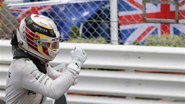 Mercedes driver Lewis Hamilton of Britain celebrates