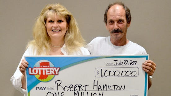 Robert Hamilton in July won a $1 million lottery prize for the second time in three months. His wife, Donna Hamilton, is shown here with him.