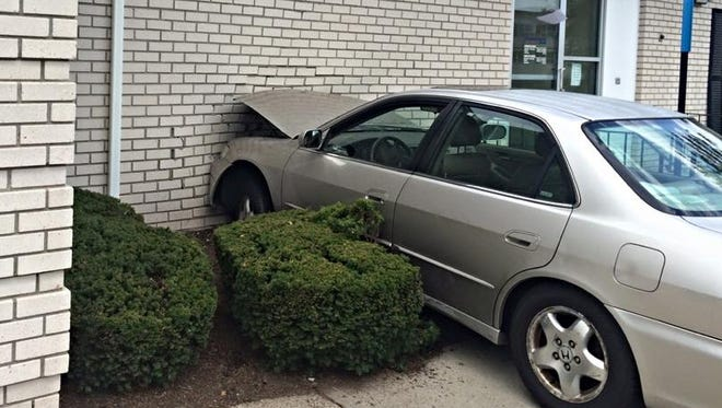Car that slammed into People's United Bank on North Main Street in Hillcrest, Aug. 24, 2015.