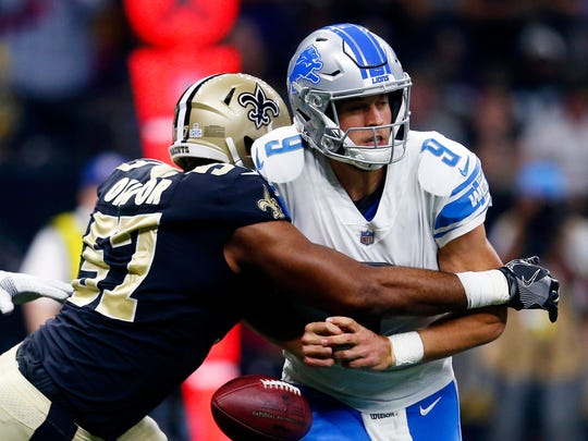 Lions QB Matthew Stafford fumbles as he is hit by Saints