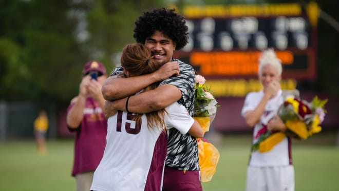 ASU linebacker Salamo Fiso hugs girlfriend Christina Rebata during ASU soccer Senior Day.