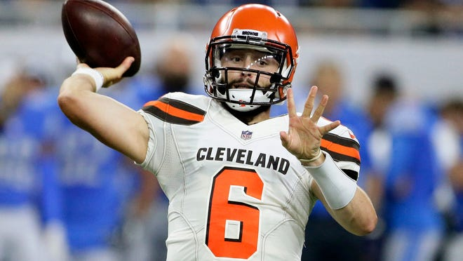 FILE - In this Aug. 30, 2018, file photo, Cleveland Browns quarterback Baker Mayfield throws during the first half of an NFL football preseason game against the Detroit Lions in Detroit. New York Jets quarterback Sam Darnold didn't have exactly what the Browns were looking for in a franchise quarterback. They passed on him and took Baker Mayfield with the No. 1 overall pick instead. On Thursday night, Darnold gets to show Cleveland if it made another mistake. (AP Photo/Duane Burleson, File)