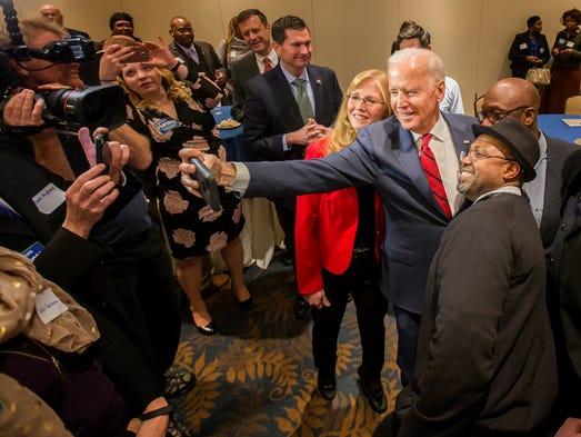Former Vice President Joe Biden takes a selfie with