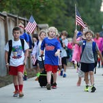 A parade of students heads north along Rice Road in Madison Wednesday morning headed to Madison Avenue Lower and Upper Elementary Schools on the city's 10th annual Walk to School Day.