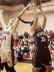 Susquehannock's Tyler Williams (24) and Mechanicsburg's