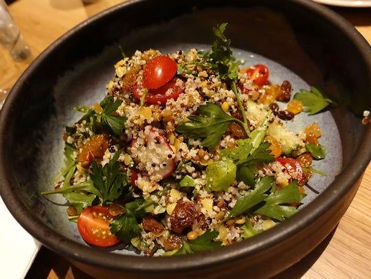 Ensalada legumbres with quinoa, lentils, tomato, cucumber,