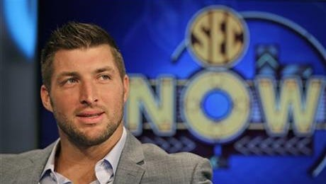 Tim Tebow ponders a question during an interview on the set of ESPN's new SEC Network in Charlotte, N.C., Wednesday, Aug. 6, 2014.