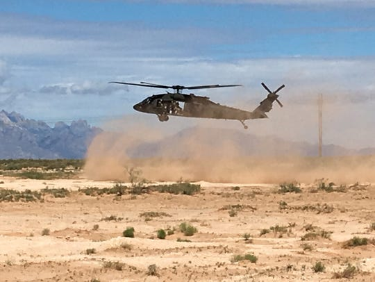 A Black Hawk helicopter lands during a past Network Integration Evaluation at Fort Bliss.
