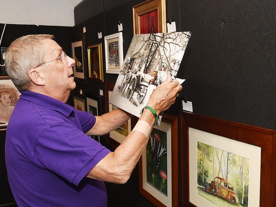 Tom Keeley, event committee chairman, hangs submissions for the Second annual Joint Members Show at the Millsboro Art League Gallery. <137>located at 203 Main Street in Millsboro.<137>
