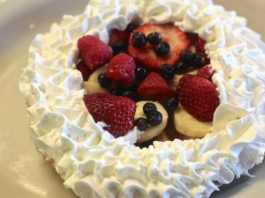 Louise's Pantry in La Quinta offers a variety of breakfast food including the Belgium waffle with fruit topped with real whipped cream. Breakfast at Louise's Pantry is served until 2 p.m.