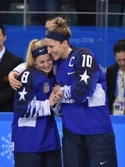 United States defenseman Emily Pfalzer (8) and forward Meghan Duggan (10) celebrate after defeating Canada in the women's ice hockey gold medal match during the Pyeongchang 2018 Olympic Winter Games at Gangneung Hockey Centre.