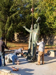 The statue of Billy Graham being installed at Ridgecrest.