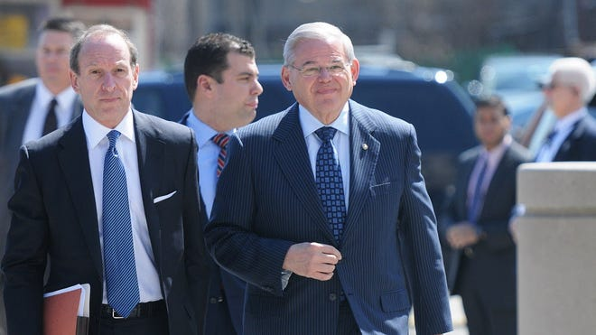 Sen. Bob Menendez, right, is accused of taking bribes in exchange for using his office to benefit the personal and private interests of co-defendant Salomon Melgen, a longtime friend who is a Florida eye specialist.