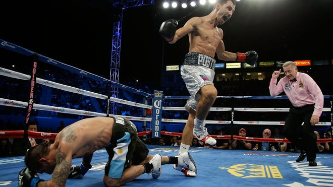 Viktor Postol celebrates after knocking out Lucas Matthysse to win the WBC title. (Photo by Jeff Gross/Getty Images)