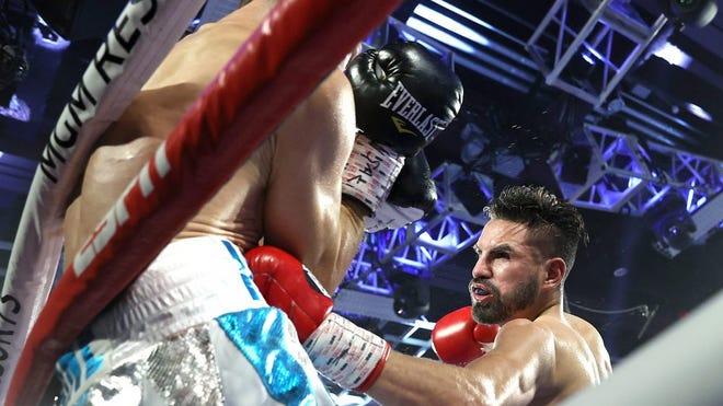 Jose Ramirez has Viktor Postol against the ropes during his victory on Aug. 29 in Las Vegas.