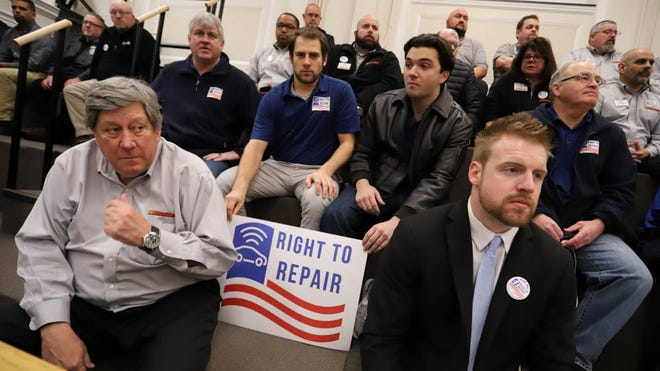 """Supporters of the proposed update to the """"Right to Repair"""" ballot law, including Right to Repair Coalition director Tommy Hickey, bottom right, waited for the start of a crowded Consumer Protection Committee hearing on Jan. 13, 2020."""