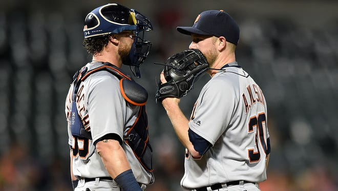 Tigers pitcher Alex Wilson, right, and catcher Jarrod Saltalamacchia talk with two runners on in the seventh inning of the Tigers' 7-5 loss Thursday in Baltimore.