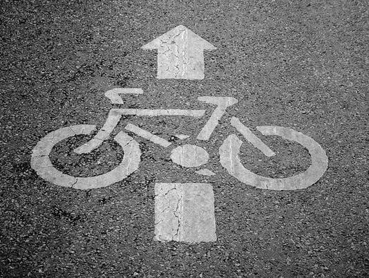 #stockphoto bicycles sign on bicycle pathway in the park