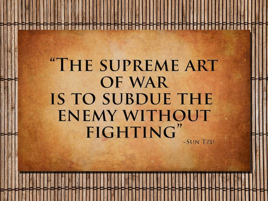 The Supreme art of war is to subdue the enemy without fighting. Quote by Sun Tzu over stone and bamboo.